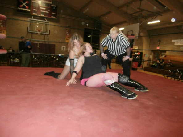Autumn Breeze taking the fight to Princess Chrissy Johnson while ref Pryme Tyme Amy Lee looks on.
