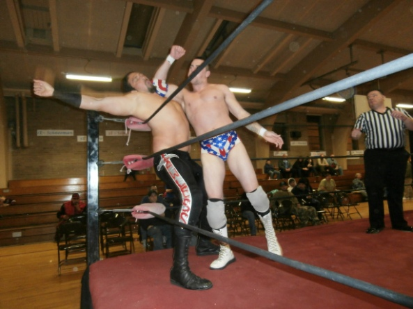 Braydon Knight delivers a crushing elbow to Rex Lawless